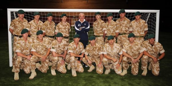 SPECIAL PICTURE - RELEASED EXCLUSIVELY THROUGH THE PRESS ASSOCIATION FOR USE BY NATIONAL AND REGIONAL NEWSPAPERS - UK & IRELAND ONLY. NO SALES. Rangers manager Walter Smith meets members of the armed forces during training at Murray Park, Glasgow