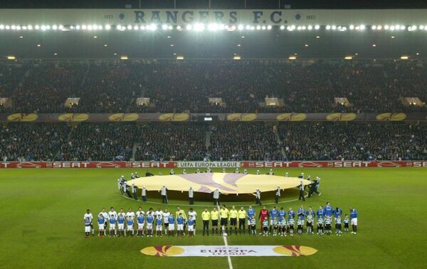 Rangers and Sporting Lisbon team line up before the game