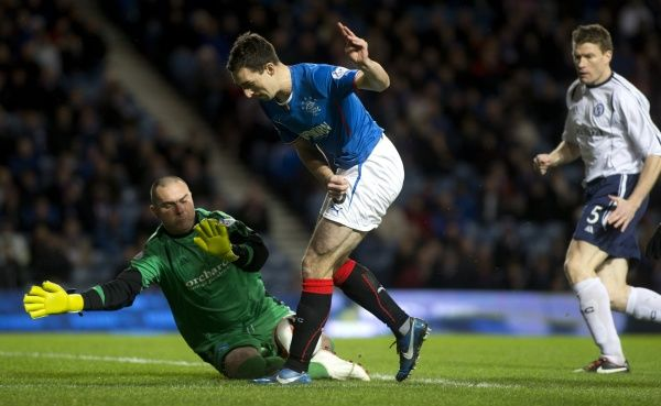 Rangers' Lee Wallace and Forfar Athletic's goal keeper Darren Hill