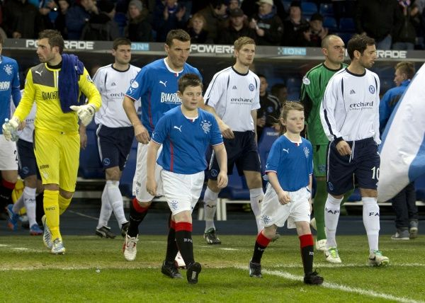 Rangers captain Lee McCulloch leads out his players and mascots