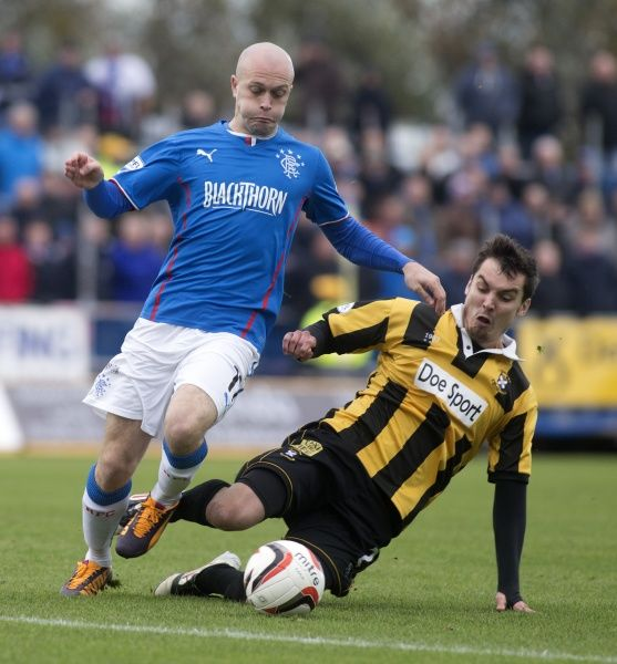 Rangers' Nicky Law and East Fife's Alexis Dutot during the Scottish League One match at Bayview Stadium