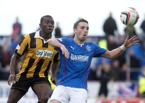 Rangers' Nicky Clark and East Fife's Joe Mbu during the Scottish League One match at Bayview Stadium