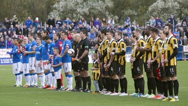Rangers and East Fife players line up prior to kick off at the Scottish League One match at Bayview Stadium