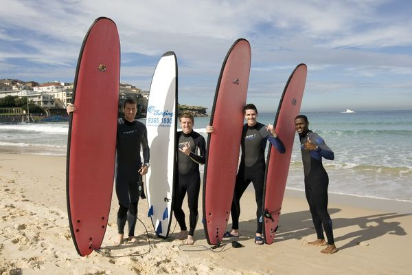 EXCLUSIVE - Rangers' (L-R) Kirk Broadfoot, Steven Davis, Kyle Lafferty and Maurice Edu go surfing on Bondi Beach