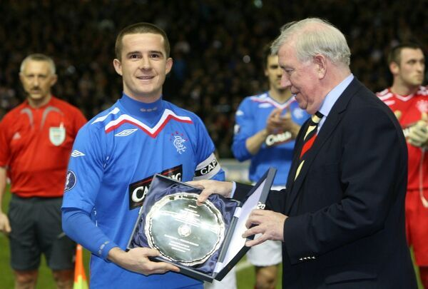 Barry Ferguson is presented with award for reaching Scottish record of 77 European appearances from John Greig, Rangers