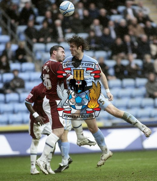 Burnley's David Unsworth (left) and Coventry City's Elliott Ward battle for the ball