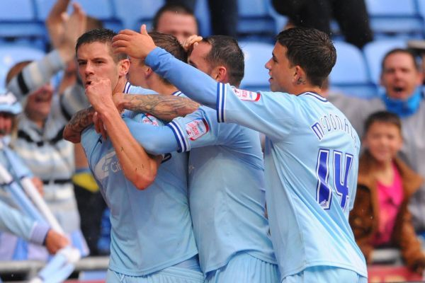 Coventry City's Lukas Jutkiewicz (left) celebrates scoring from the penalty spot during the npower Football League Championship match at the Ricoh Arena, Coventry