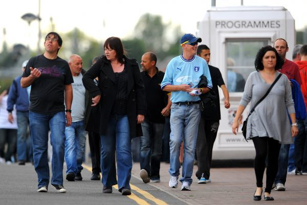 Coventry City fans arrive for the npower Football League Championship match at the Ricoh Arena