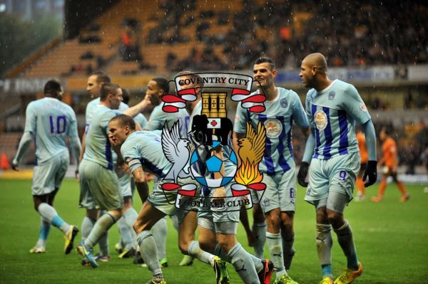 Coventry City's sub Aaron Phillips (centre) celebrates equalizing goal with team mates