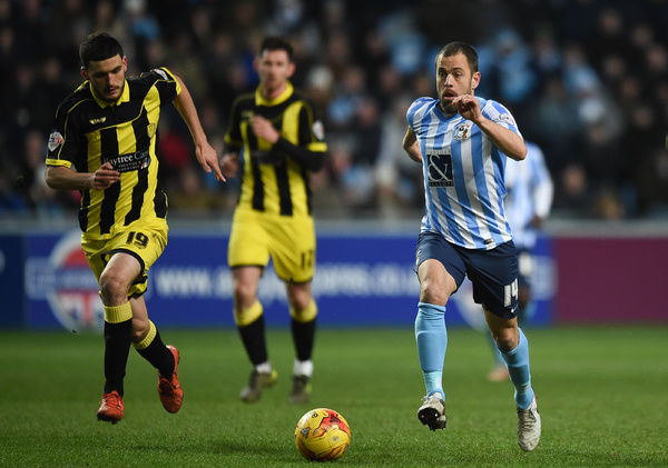 Burton Albion's Anthony Oa??AoConnor and Coventry City's Joe Cole