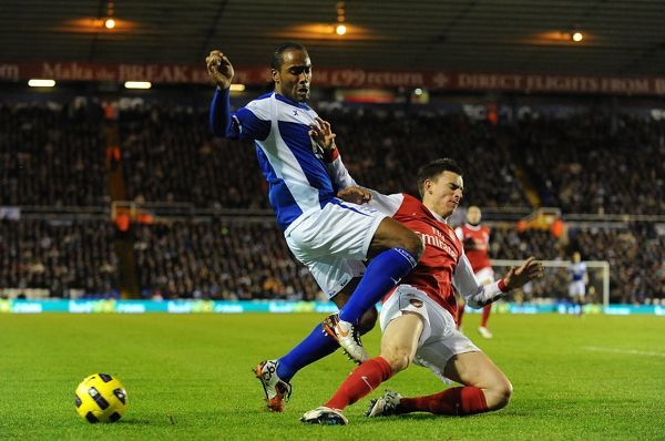 Arsenal's Laurent Koscielny (right) and Birmingham City's Cameron Jerome (left) battle for the ball