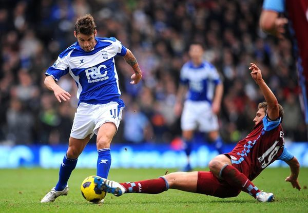 Aston Villa's Stiliyan Petrov (right) slides in to win the ball ahead of Birmingham City's David Bentley