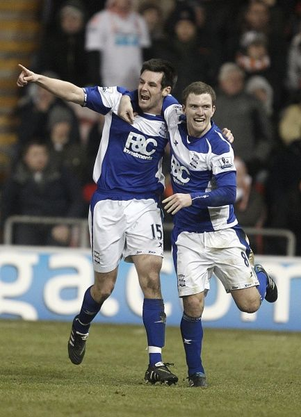 Birmingham City's Scott Dann (left) celebrates with team-mate Craig Gardner (right) after scoring their second goal