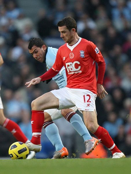 Manchester City's Carlos Tevez (left) and Birmingham City's Barry Ferguson (right)