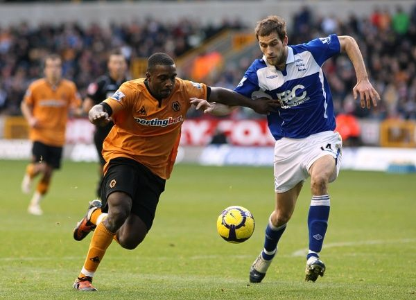 Birmingham City's Roger Johnson (right) and Wolverhampton Wanderers' Sylvan Ebanks-Blake (left) battle for the ball