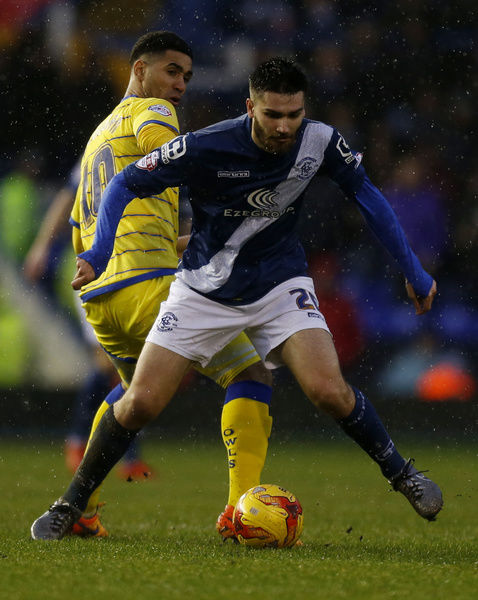 Birmingham City's Jon Toral and Sheffield Wednesday's Lewis McGugan (left) in action