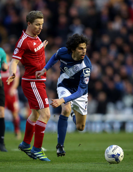 Middlesbrough's Grant Leadbitter (left) and Birmingham City's Diego Fabbrini battle for the ball during the Sky Bet Championship match at St Andrew's, Birmingham