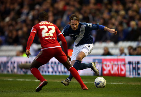 Birmingham City's Jonathan Grounds and Middlesbrough's Albert Adomah (left) battle for the ball during the Sky Bet Championship match at St Andrew's, Birmingham