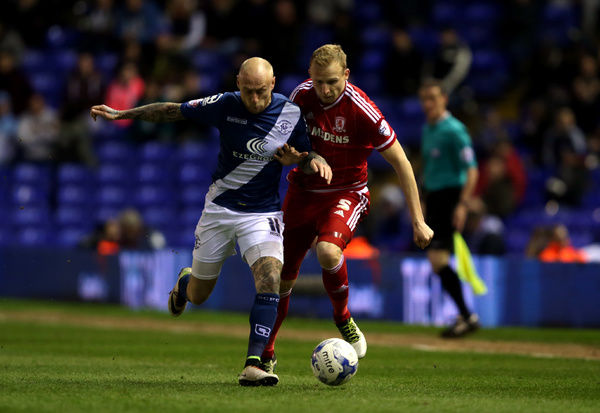 Birmingham City's David Cotterill (left) and Middlesbrough's Richie De Laet battle for the ball during the Sky Bet Championship match at St Andrew's, Birmingham