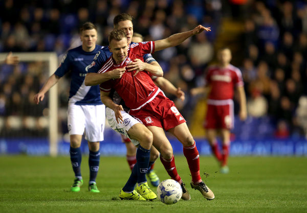 Middlesbrough's Jordan Rhodes (front) and Birmingham City's Michael Morrison battle for the ball during the Sky Bet Championship match at St Andrew's, Birmingham