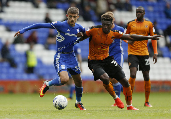 Birmingham City's Jack Storer and Wolverhampton Wanderers' Kortney Hause