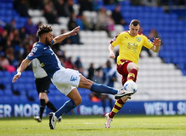 Birmingham Citya??is Ryan Shotton and Burnleya??is Dean Marney battle for the ball during the Sky Bet Championship match at St Andrews, Birmingham