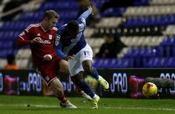 Birmingham City's Jacques Maghoma and Cardiff City's Aron Gunnarsson battle for the ball during the Skybet Championship match at St Andrew's, Birmingham