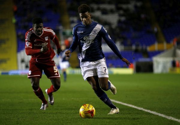 Birmingham City's Demarai Gray and Cardiff City's Bruno Ecuele Managa battle for the ball during the Sky Bet Championship match at St Andrew's, Birmingham