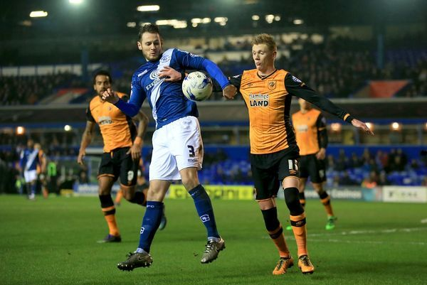 Birmingham City's Jonathan Grounds (left) and Hull City's Sam Clucas battle for the ball during the Sky Bet Championship match at St Andrews, Birmingham