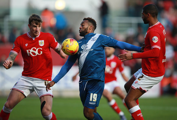 Bristol City's Mark Little and Aden Flint and Birmingham City's Jacques Maghoma