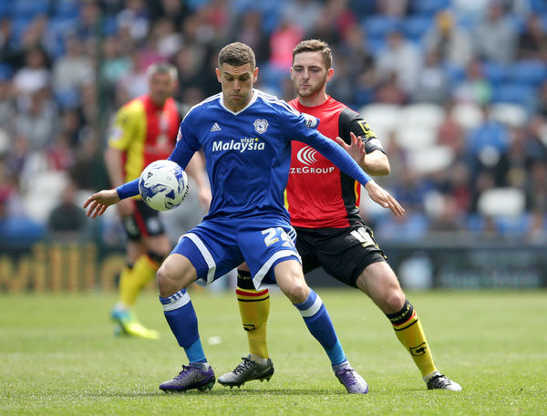 Cardiff City's Stuart OiKeefe (left) and Birmingham City's Charlee Adams battle for the ball