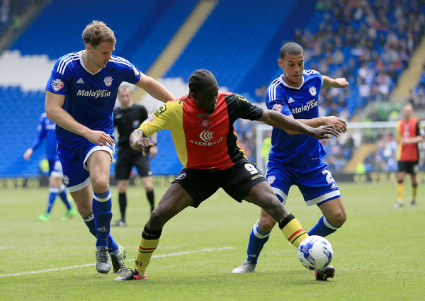 Birmingham City's Clayton Donaldson (centre) takes on Cardiff City's Ben Turner (left) and Lee Peltier