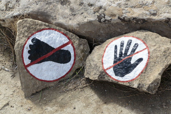Azerbaijan, Qobustan. A warning to not touch or walk on the rocks at Gobustan National Park