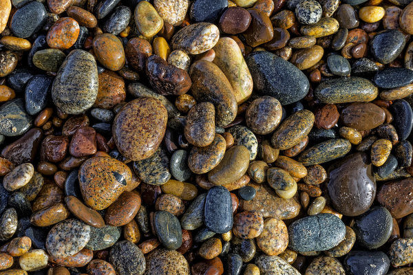 Smooth granite pebbles on beach of Lake Superior, Whitefish Point, Upper Peninsula