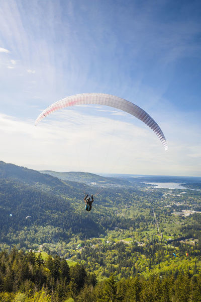 United States, Washington, Issaquah. Paragliders launch from Tiger Mountain and soar westward towards Issaquah