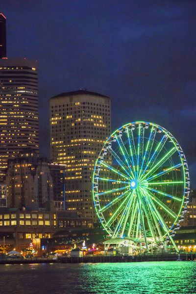 United States, Washington, Seattle. The downtown skyline at dusk, seen from Elliott Bay looking east, featuring the Seattle Great Wheel