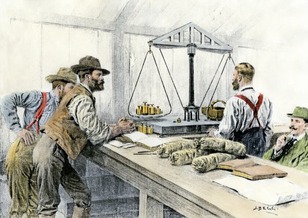 Klondike miners weighing their gold in a Dawson City bank, 1898. Hand-colored halftone of a 19th century illustration