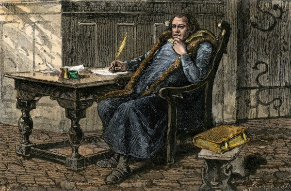 Martin Luther at his desk. Hand-colored woodcut of a 19th-century illustration
