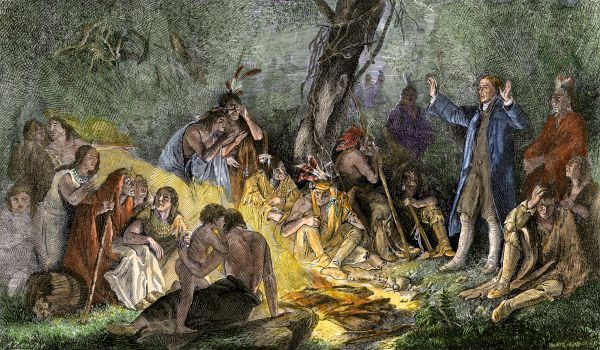 Moravian missionary David Zeisberger preaching to Native Americans in Pennsylvania, 1760s. Hand-colored woodcut of a painting by Schuessele