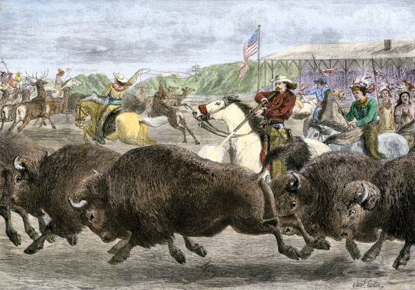Buffalo Bill Cody's Wild West Show hunting bison and elk, 1880s. Hand-colored woodcut of a 19th-century illustration