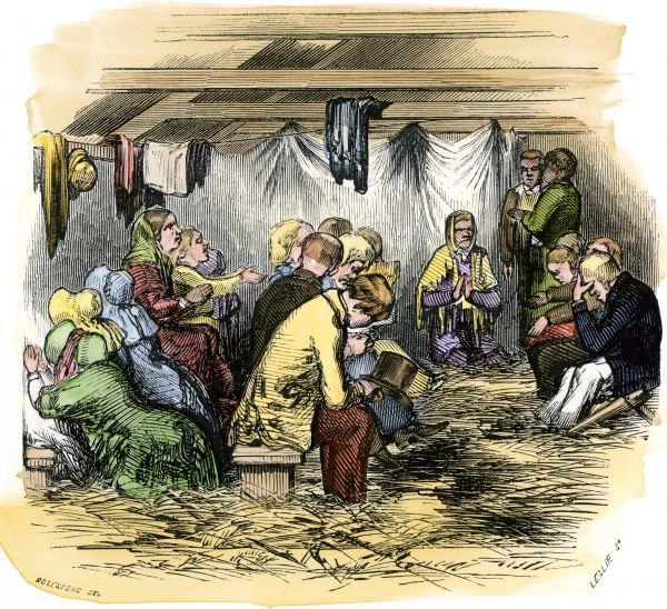 Religious revival prayer meeting held in a tent, 1850s. Hand-colored woodcut of a 19th-century illustration