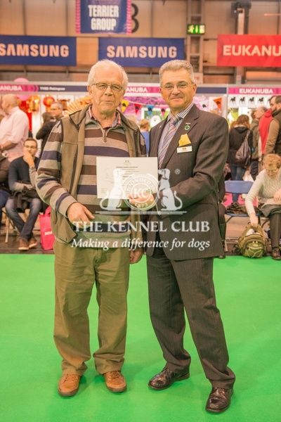 Paul Rawlings, Chairman of the Working Gundog Certificate Working Party awards a certificate to MrGraham Clelland for his dog Necessares Rawden