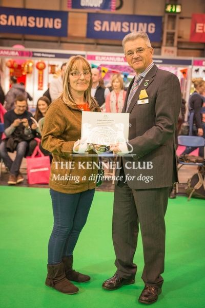 Paul Rawlings, Chairman of the Working Gundog Certificate Working Party awards a certificate to Mrs Caroline Knight for her dog Colleton Caro