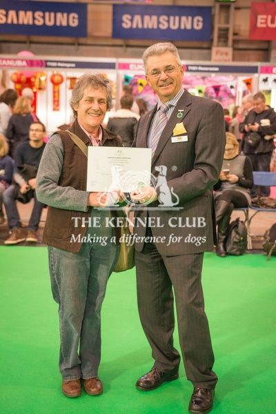 Paul Rawlings, Chairman of the Working Gundog Certificate Working Party awards a certificate to Mrs Ann turner for her dog Kestrelway Daisy