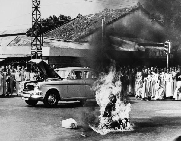 Buddhist monk Thich Quang Duc (1897-1963) committing self-immolation at an intersection in Saigon, South Vietnam, in protest against the anti-Buddhist measures of President Ngo Dinh Diem and his treatment of protestors, 11 June 1963. Photographed by Malcolm Browne
