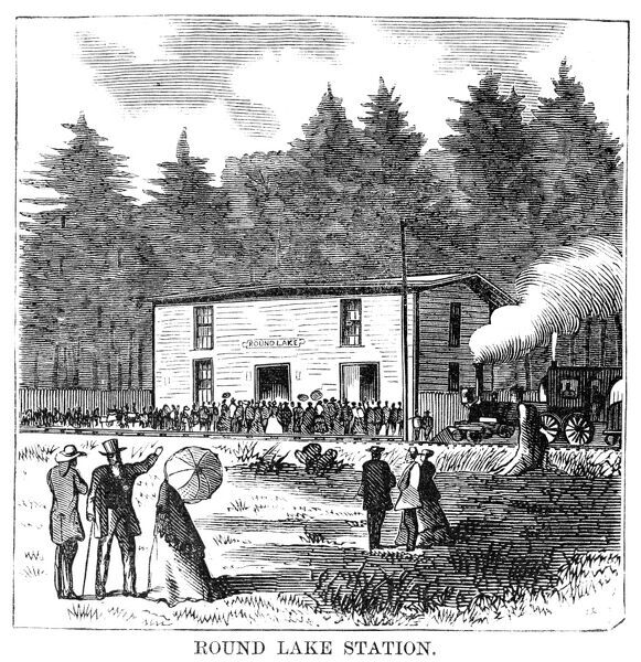 CAMP MEETING, 1869.   Round Lake Station at Round Lake, New York, the site of the national camp meeting, 6-15 July 1869. Contemporary American wood engraving
