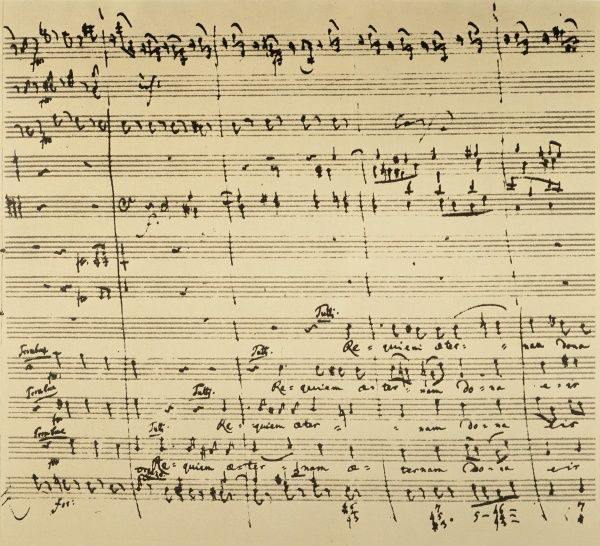 MOZART: REQUIEM EXCERPT.  Autograph manuscript excerpt of Wolfgang Amadeus Mozart's unfinished 'Requiem,' 1791, featuring the chorus 'Requiem aeternam dona eis, Domine' (Give them eternal peace, oh Lord)