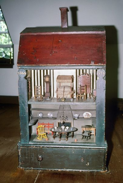 COLONIAL DOLLHOUSE, 1744.  Painted pine dollhouse manufactured for the Homans family of Boston, Massachusetts, 1744