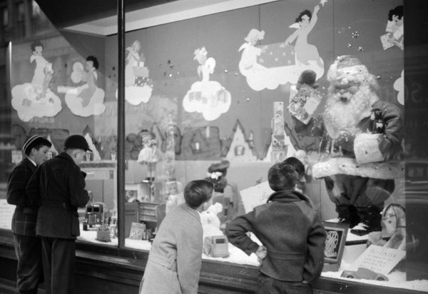 WINDOW SHOPPING, 1940. Window shoppers looking at toys in the window display of
