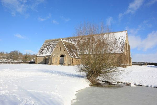 A cold winters day at Great Coxwell Barn near Faringdon Oxfordshire, A large monastic barn with a very fine stone roof and interesting timbers